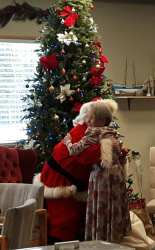 santa hugging lucky